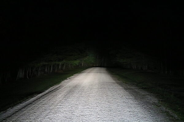 Open dirt road with awesome headlights lighting the way